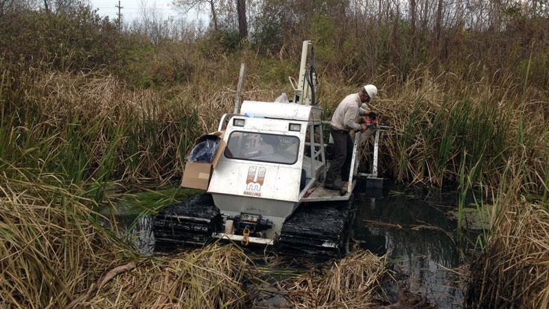 Marsh master in wetlands sediment sampling