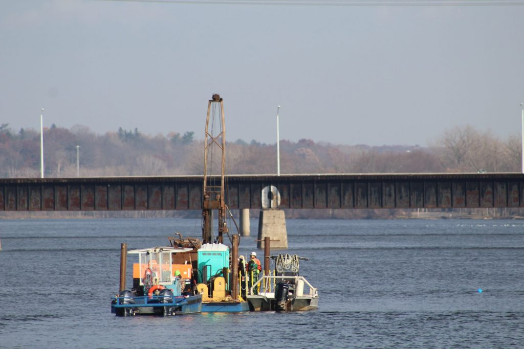 drilling barge collecting samples from water